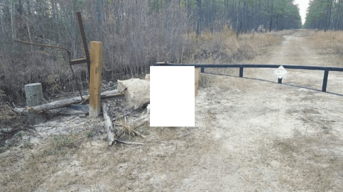 Hunting Dog Shot, Killed, Hung From Gate Next to Handwritten Sign