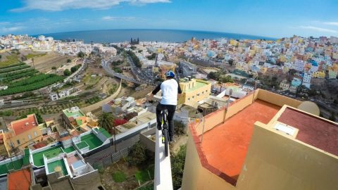 Insane Rooftop Bike Ride Creates Vertigo-Inducing POV Video