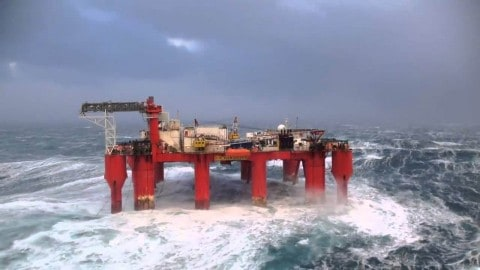 Huge Waves Battering a Swaying Oil Rig Will Test Your Sea-Stomach