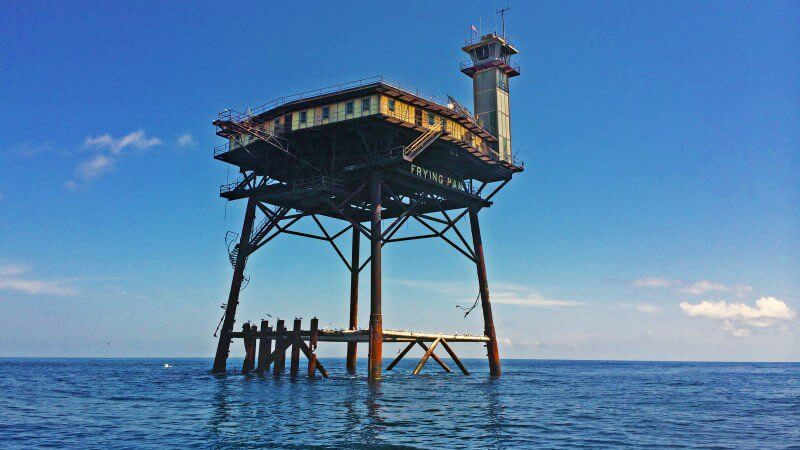 World 39 s most dangerous hotel hurricanes sharks and for Frying pan tower fishing
