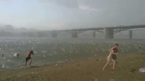 Sudden Hail Storm Wreaks Havoc on Beachgoers