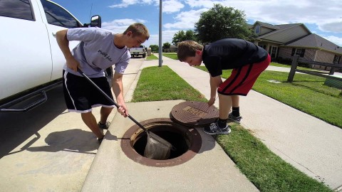Two Guys Show Their Secret Fishing Spot…A Sewer?