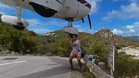 Plane Nearly Decapitates Photographer in Shocking Video