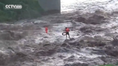 Here's The Moment A Fisherman Trapped During Flash Flood Is Saved By Zip Line