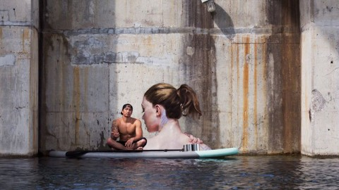 Artist Paints Incredible Portraits While Floating on a Paddleboard