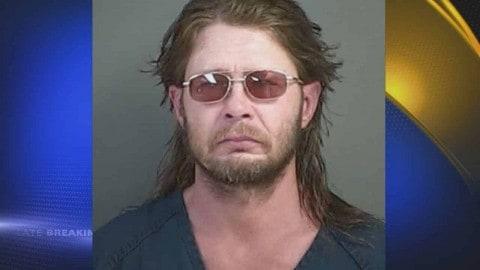 Drunk Guy Steals Beer As He Carts A Dead Deer Around Walmart
