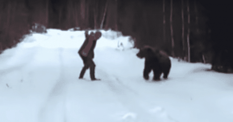 VIDEO: Madman Scares An Attacking Bear Into Running Away