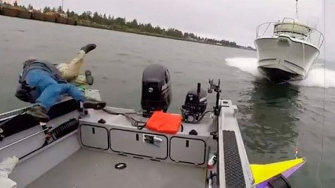VIDEO: Fisherman Jumps Out Of Boat To Avoid Being Run Over By A Bigger Boat; Now He's Suing The Helmsman