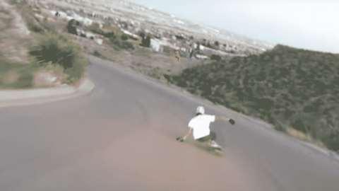 VIDEO: Longboarder Takes A Slide And Dive Off A Cliff During Insanely Fast Downhill Run