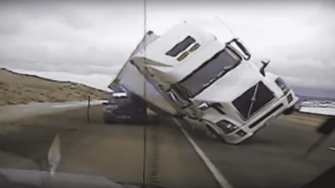 VIDEO: Semi Crushes A Police Car After Strong Winds Topple It Over