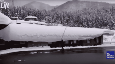 VIDEO: Snow Covered Roof Is No Match For A Man With A Stick