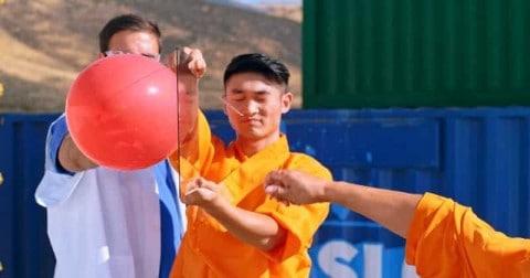 VIDEO: Slow Mo Guys Watch A Monk Throw A Needle Through Glass