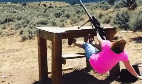 Watch A .50 BMG Sweep This Woman Right Off Her Feet