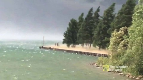 VIDEO: Insane Winds Sweep In Over Lake And Sends People Running
