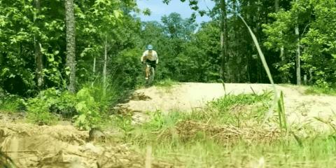 Mountain Biker Has Rough Landing After A Jump