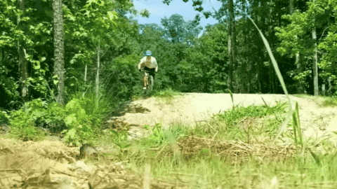 Mountain Biker Has Rough Landing After A Jump