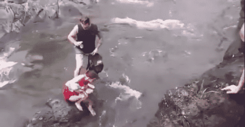 VIDEO: Couple Gets Swept Over Waterfall By Flash Flood