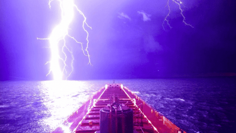 Incredible Photo Captures Massive Lightning Bolt On Lake Michigan, Goes Viral