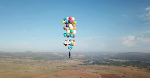 VIDEO: Man Pulls An 'Up,' Straps 100 Balloons To A Chair And Takes It For A Ride