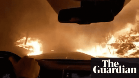 VIDEO: Family Drives Down Flaming Road As They Escape Fast Spreading Wildfire