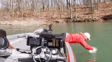 VIDEO: Anglers Line Breaks While Reeling In A Bass, So He Dives In After It